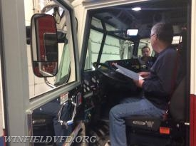 FF Scott Dayhoff examines the dashboard layout of a new Pierce pumper in order to examine the types of light control switches available.